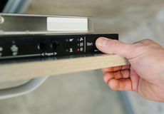 Run the dishwashing machine. Stock Photos