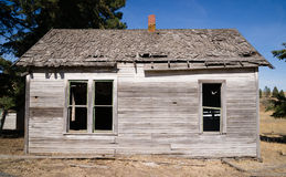 Run Down Abandoned Farm House Bleached Rotting Wood. Look at the rock foundation on this house that will soon be dust Royalty Free Stock Photos