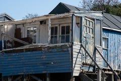 Run down blue wooden coastal shack royalty free stock images