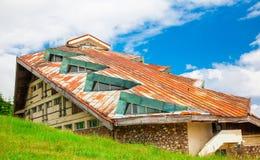 Run down building in Semenic, Romania. The roof of a run down building, in Semenic mountain resort, Romania stock photo