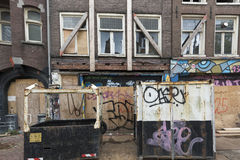 Run down buildings in Amsterdam. In the center of Amsterdam, a number of houses were squatted in the 80's. In 2015 the government evicted the squatters and gave Stock Photos