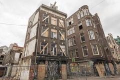 Run down buildings in Amsterdam. In the center of Amsterdam, a number of houses were squatted in the 80's. In 2015 the government evicted the squatters and gave Royalty Free Stock Photo