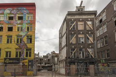 Run down buildings in Amsterdam. In the center of Amsterdam, a number of houses were squatted in the 80's. In 2015 the government evicted the squatters and gave Stock Images