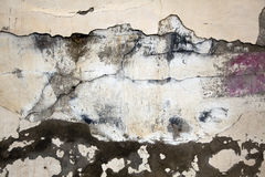Neglected Wall. A run-down cracked and almost completely peeled from paint wall Royalty Free Stock Image