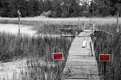 Run Down Dock. No Trespassing Signs by an Old Run Down Dock royalty free stock photos