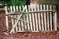 Run Down Fence. An Old Run Down White Fence Almost Falling Over royalty free stock photo