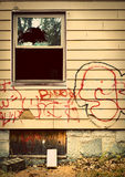 Run down house with graffiti Royalty Free Stock Photography
