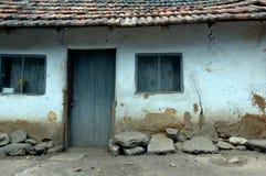 Run-down hut. A rural run-down hut with cracked mud walls, windows and a door stock photos