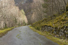 Run-down road in rural landscape Royalty Free Stock Photo