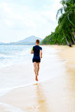 Run. Fit Athletic Man Running On Beach. Exercising. Healthy Life. Run. Fit Athletic Man Running On Beach, Male Athlete Runner Jogging On Wet Sand During Outdoor Royalty Free Stock Photos