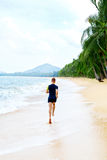 Run. Fit Athletic Man Running On Beach. Exercising. Healthy Life. Run. Fit Athletic Man Running On Beach, Male Athlete Runner Jogging On Wet Sand During Outdoor Royalty Free Stock Photo