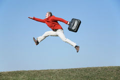 Run fly man with bag Stock Photo