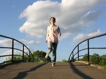 Run girl on bridge Stock Photography