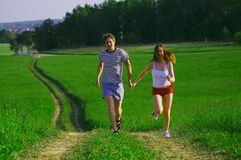 Run with love. Men and women run and smile Royalty Free Stock Photo