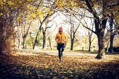 Run outside, young man exercise. One man only exercise in park Stock Photos