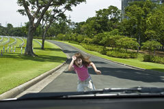 Run over. Girl nearly run over by a car Stock Photography