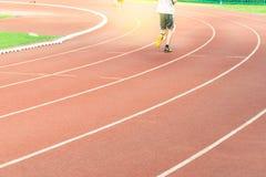 Run race track in sport stadium. Run race track and running man in sport stadium royalty free stock images