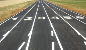 Run Run. Closeup of a track an field stadium and the lane numbers Stock Image