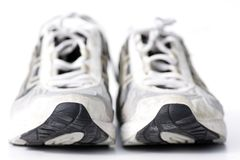 Run run run. Pair of running-shoes on white, very shallow depth of field Royalty Free Stock Photo