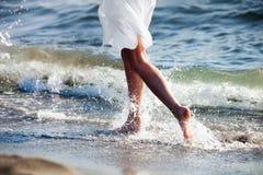 Run at sandy beach stock images
