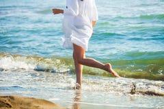 Run at sandy beach Royalty Free Stock Photos