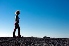 Before The Run. Silhouette Of Woman On The Beach Preparing For The Morning Run Royalty Free Stock Photography