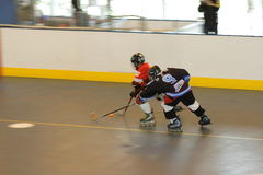 Run to catch. Team IceMan VS Stags in 2008 Hong Kong Inline Cup (Youth) inside YMCA King's Park Centenary Centre Royalty Free Stock Image