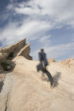 Run to the top. Businessman climbing a mountain; metaphor for the climb to success Royalty Free Stock Photos