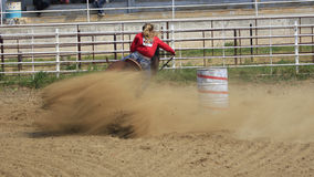 Run it to win it. Young girl competing in barrel racing competition Royalty Free Stock Photo