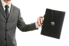 Run to work. Close-up of businessman with briefcase in hand isolated on white background Stock Images