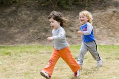 Run Together. Running children the boy and the girl Stock Photo