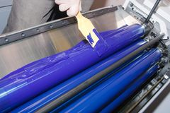 Run-up of color. Printer is running ink down at offset printed machine Stock Photo