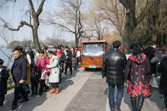 Day After Chinese New Year Xin nian - Electric bus in crowd what people do. In the run up to chinese new year the roads are often very busy, as people move to stock photos