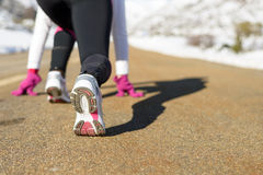Run in winter road concept. Sportswoman runing on winter concept. Female athlete ready to run on mountain snowy road. Copy space Stock Photography