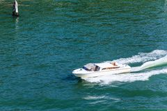 Runabout in Venice. A small private boat in the canals of Venice Royalty Free Stock Photography