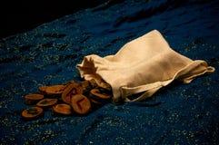 Runas de la adivinación en el paño azul Imagen de archivo libre de regalías