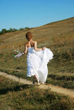 Runaway bride. Bride running to the new life Stock Image