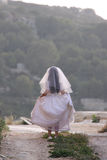 Runaway bride. A, little girl dressed up as a bride for her Holy Communion is walk Stock Photos