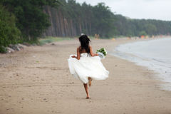 Runaway bride. In the rain Stock Photography