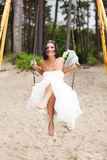 Runaway bride. On a swing Stock Photography