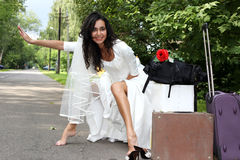 Runaway Bride hitch-hiking Royalty Free Stock Image