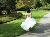 Runaway Bride. A bride runs away on her wedding day Royalty Free Stock Photography