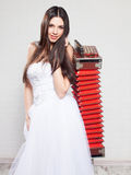 Runaway Bride. With Russian accordion. Bride sneakers. Wedding Royalty Free Stock Photography