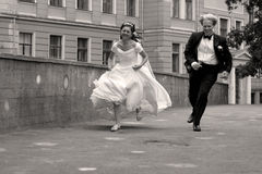 Runaway couple. Ritual hurdle-race for just married pair, Riga, Latvia Stock Photos