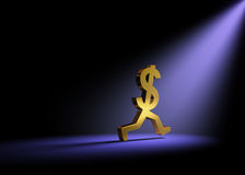 Runaway Expenses. A gold dollar sign in the dark is caught in a bright spot light as it runs away Stock Images