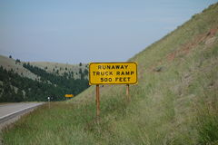 A runaway truck sign in the mountains. Royalty Free Stock Image