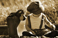 Free Runaway Vintage Sepia Boy & Small Suitcase & Teddy Stock Photos - 30859063