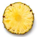 Rund ananasskiva med hud som isoleras på vit Arkivbild