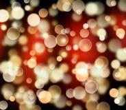 Rund bokeh på rött lyxigt mörker -, bryna, svärta bakgrund Arkivbild