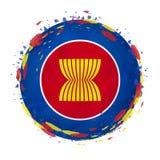 Rund grungeflagga av ASEAN med färgstänk i flaggafärg vektor illustrationer